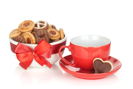 Red coffee cup and cookies. Isolated on white background photo