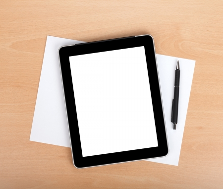 Tablet with blank screen and pen over white papers. View from above