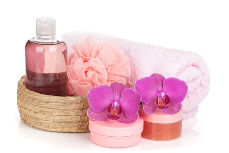 Cosmetics, towel and orchid flowers. Isolated on white background photo