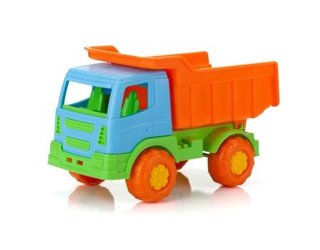 juguetes antiguos: Coche de juguete de color. Aislado en el fondo blanco Foto de archivo