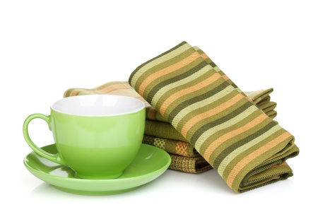 Coffee cup and kitchen towels. Isolated on white background photo