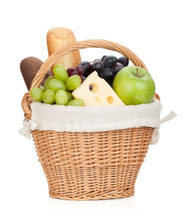 bread basket: Picnic basket with bread and fruits. Isolated on white background