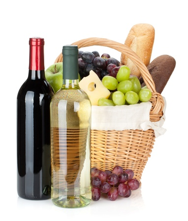 Picnic basket with bread, cheese, grape and wine bottles. Isolated on white background photo