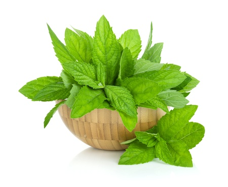 spearmint: Wood bowl with fresh mint  Isolated on white backround