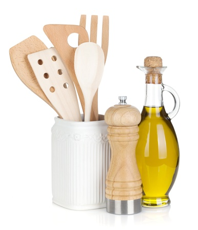 Kitchen utensils in holder and condiments  Isolated on white background photo