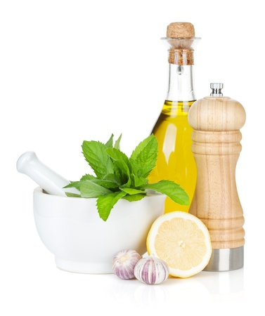 Condiments and herbs  Isolated on white background photo