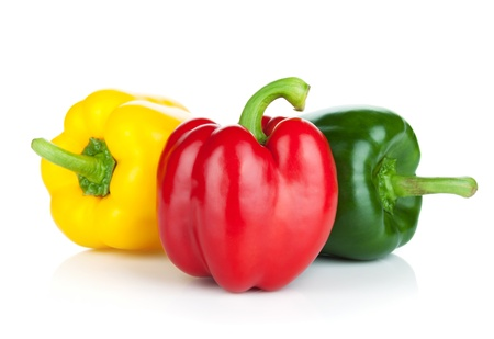 capsicums: Colorful bell peppers  Isolated on white background