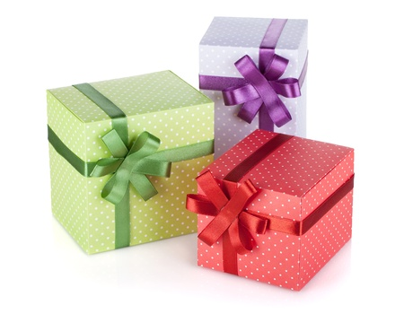Three colorful gift boxes with ribbon and bow isolated on white three colorful gift boxes with ribbon and bow isolated on white stock photo picture and royalty free image image 20484495 negle Choice Image