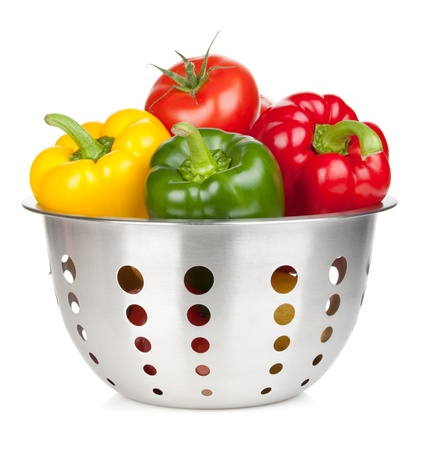 Fresh ripe vegetables in colander. Isolated on white background photo