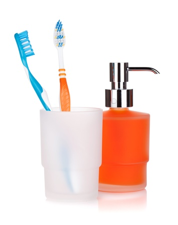 bathroom equipment: Two colorful toothbrushes and liquid soap. Isolated on white background Stock Photo