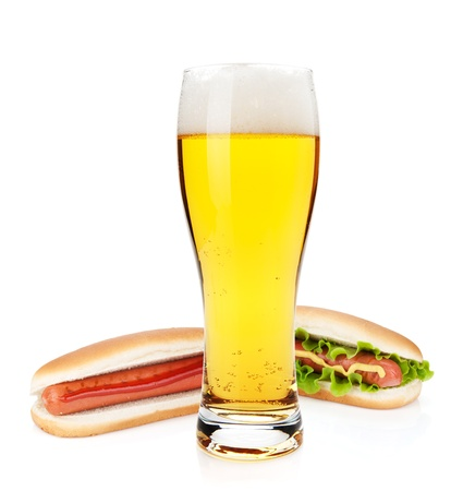 mug of ale: Beer glass and two hot dogs with various ingredients. Isolated on white background Stock Photo
