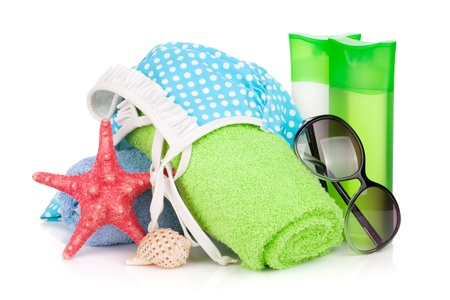 Swimming suit and beach items  Isolated on white background photo