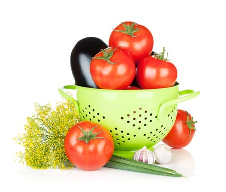 Fresh ripe vegetables in colander  Isolated on white background Stock Photo - 20836276