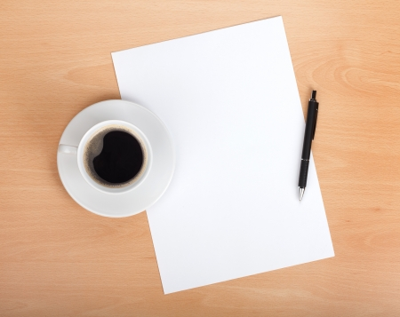 Blank paper with pen and coffee cup on wood table Stock Photo - 20837194