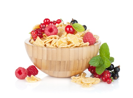 Fresh corn flakes with berries in bowl. Isolated on white background photo
