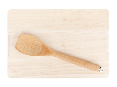 Cooking utensil on cutting board. Isolated on white background photo