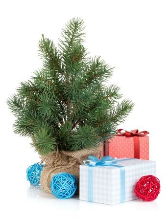 Fake mini Christmas tree with decoration and gift box. Isolated on white background photo