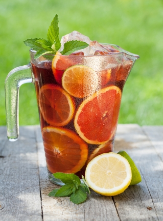 carafe: Refreshing fruit sangria (punch) on wood table Stock Photo