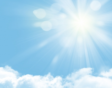 spiritual spirituality: Sunlight and blue sky over clouds background