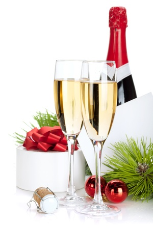Champagne and christmas gifts. Isolated on white background photo