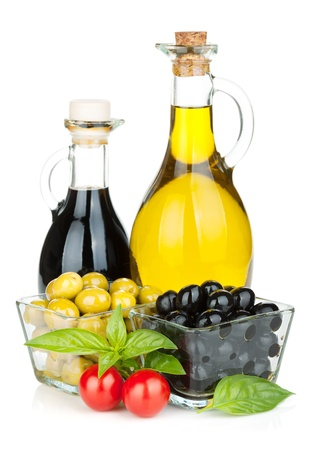 vinegar bottle: Olives, tomatoes, herbs and condiments. Isolated on white background