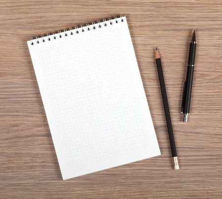 Blank notepad with pen and pencil on office wooden table Stock Photo