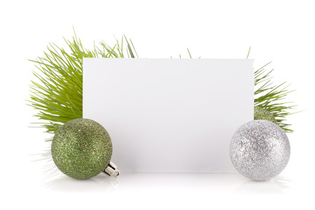 christmas greeting: Empty gift card and christmas decor. Isolated on white background Stock Photo