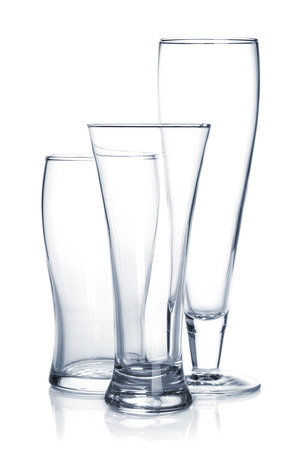Empty beer glass set. Isolated on white background photo