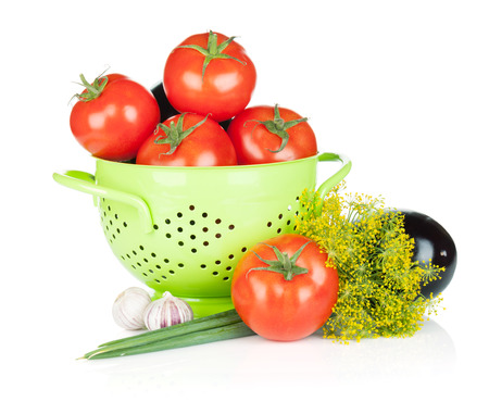 Fresh ripe vegetables in colander. Isolated on white background Stock Photo - 22437609