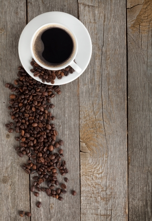 Coffee cup and beans on wooden table  photo