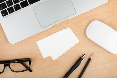 copyspace corporate: Blank business cards with supplies on wooden office table