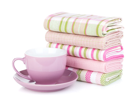 Kitchen towels and coffee cup. Isolated on white background photo