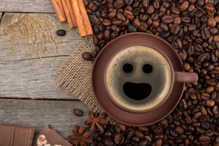 Coffee cup, spices and chocolate on wooden table texture with copy space. View from above Stock Photo - 22725641