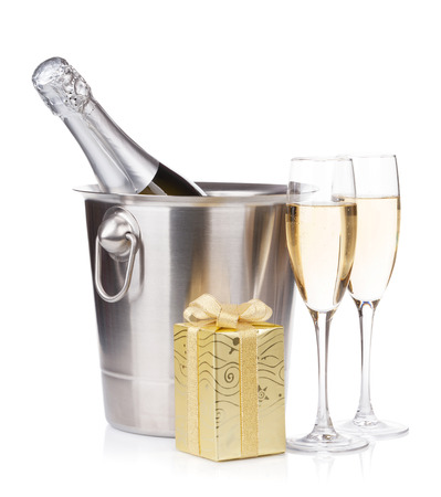 Champagne bottle in bucket, glasses and gift box.  photo