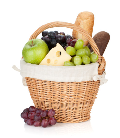 bread basket: Picnic basket with bread and fruits.