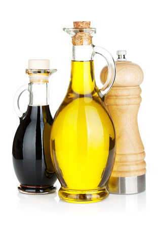 Olive oil and vinegar bottles with pepper shaker. Isolated on white background photo