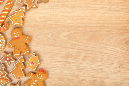 Homemade various christmas gingerbread cookies on wooden background with copy space photo