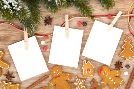 Blank christmas photo frames with fir tree and gingerbread cookies