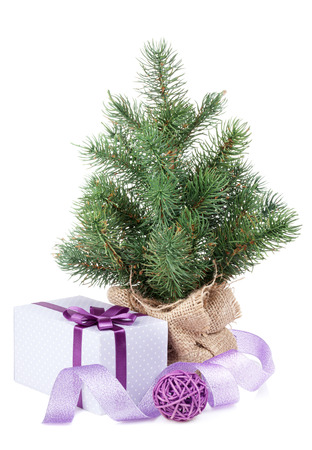 small christmas tree with decor and gift box isolated on white background stock photo - Small Purple Christmas Tree