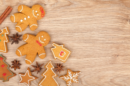 Homemade various christmas gingerbread cookies on wooden background photo