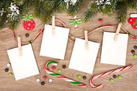 Blank christmas photo frames with fir tree and decor