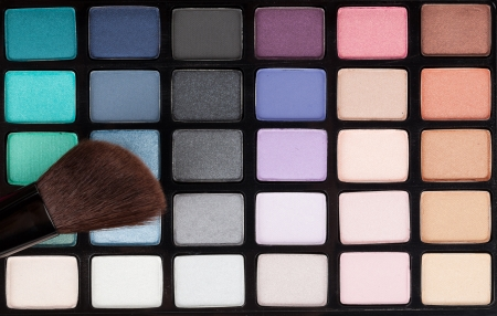 Professional makeup colorful palette and brush photo