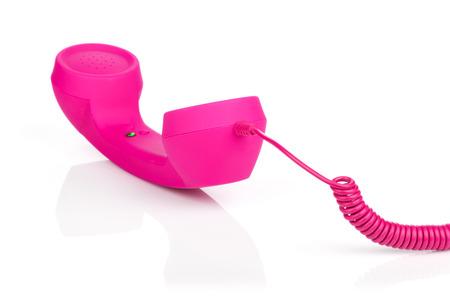 Téléphone vintage rose. Isolé sur fond blanc Banque d'images - 23519273