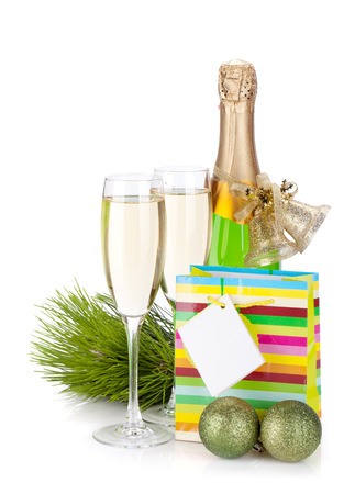 two year: Champagne, gift and christmas decor. Isolated on white background Stock Photo
