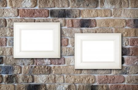 Photo frames on brick wall background photo