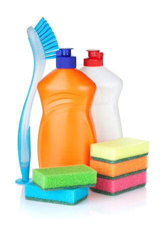 Plastic bottles of cleaning products, sponges and brush. Isolated on white background photo