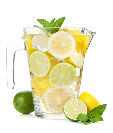 Homemade lemonade with citruses. Isolated on white background photo