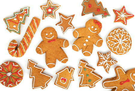 Homemade various christmas gingerbread cookies on white background photo