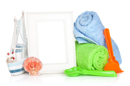 Photo frame with beach towels and toys. Isolated on white background photo