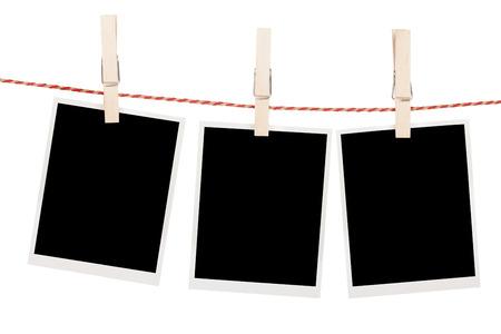 Blank photos hanging on clothesline. Isolated on white background photo